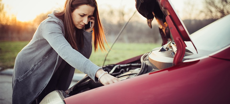 Woman-Standing-Over-Broken-Down-Car