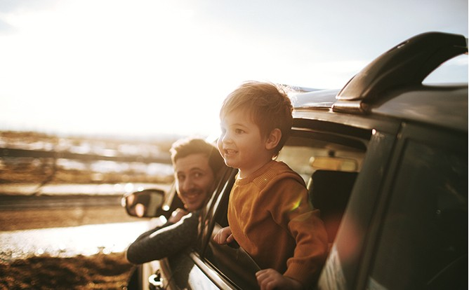 Man-and-Boy-Hanging-Out-of-Car-Windows