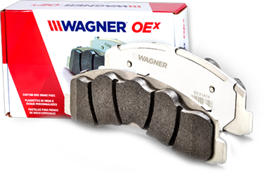 A Wagner OEx  brake pad displayed next to the products box