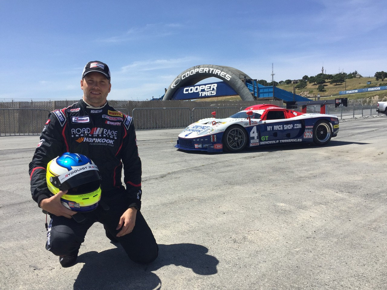 carl-rydquist-posing-with-race-car