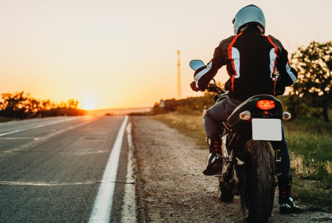Motorcycle-Rider-On-Side-Of-Road
